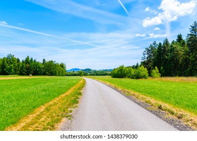 Cycling road around Tatra Mountains and green field in summer landscape, Poland