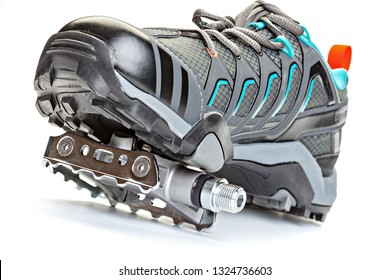 Cycling shoes with clipless sistem pedal attached to the sole  isolated on  white background. Close up.