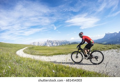 Cycling in Trentino Alto Adige on summer season. Enjoying a bike ride in Dolomites region mountains.