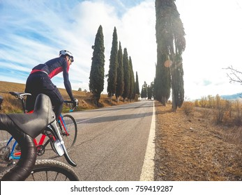 Cycling in Tuscany. Pair of cyclists enjoy a ride bike.