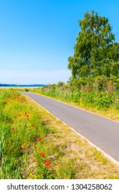 Cycling way from Baabe to Moritzdorf village in countryside spring landscape, Ruegen island, Baltic Sea, Germany