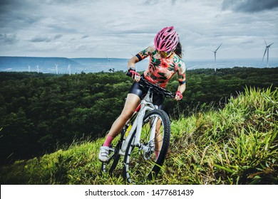 Cycling woman riding on mountainbike on the top of mountain