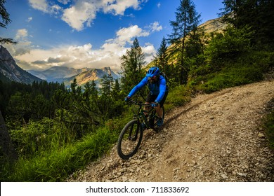 Cycling,View of cyclist riding mountain bike on single trail in Dolomites, South Tirol, Italy