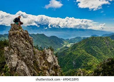 Cyclist athletes admiring the Garda Lake from Passo Tremalzo,Trails to Passo Tremalzo, Lago di Garda region, Italy, Italian Dolomites-panoramic views from the Tremalzo