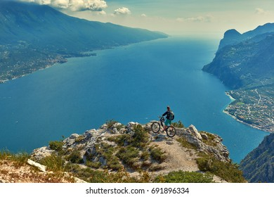 Cyclist athletes admiring the Garda Lake from Bocca Larici, Riva del Garda,Trails to Bocca Larici, Riva del Garda, Lago di Garda region, Italy, Italian Dolomites-panoramic views from the Tremalzo