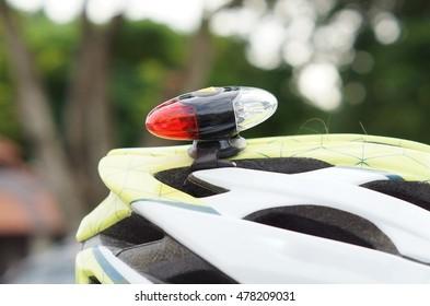 A cyclist attaching a light on helmet