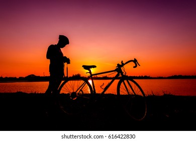 cyclist and Bicycle silhouettes on the dark background of sunsets. ride bicycle on sunset background.