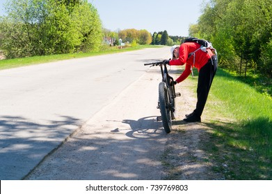 cyclist with a bicycle standing on the road. Extreme sport concept