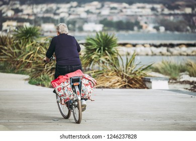 Cyclist with bicycles panniers in flowery fabric