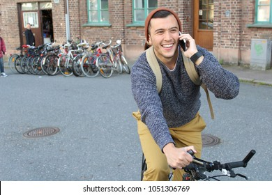 Cyclist calling by phone with copy space