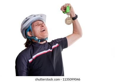 Cyclist celebrating a medal.  Celebrating the reward of hard work and endurance.