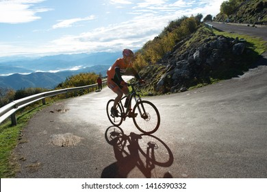 Cyclist climbing the mountain under the sun in Angliru, Asturias 11 of October 2015