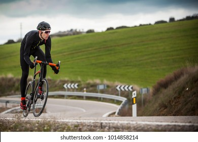 cyclist climbing the road