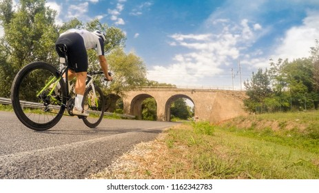 cyclist crossing a bridge
