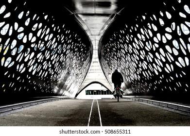 Cyclist crossing a bridge