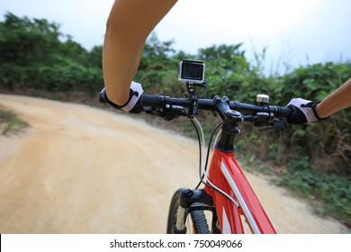 cyclist cycling mountain bike on trail