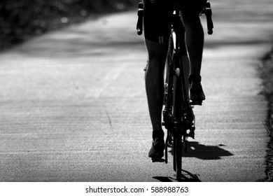 A cyclist is cycling on the road.