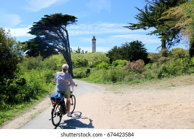 Cyclist direction of the Phare des Baleines Lighthouse on Ile de Re, France
