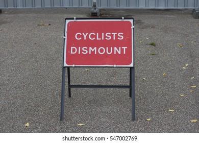 Cyclist dismount sign