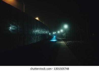 Cyclist in a foggy night