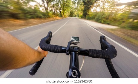 Cyclist Going down. Cycling in Tuscany countryside at sunset. POV Original point of view