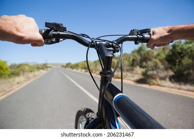 Cyclist hitting the open road on a sunny day