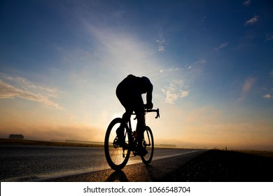 cyclist in moody sky