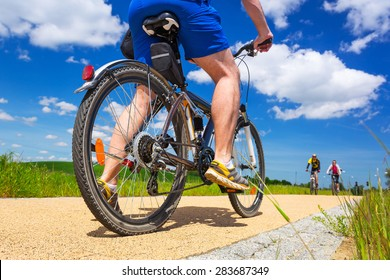 Cyclist on the bicycle road at sunny day, Poland