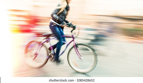 Cyclist on the city roadway in motion blur. Vintage filter with intentional color shift