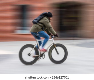 Cyclist on the city roadway in motion blur. Intentional motion blur. Defocused image