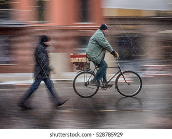 Cyclist on the city roadway in snowy day in motion blur