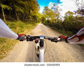 Cyclist on mountain bike in autumn. POV Original Point of View