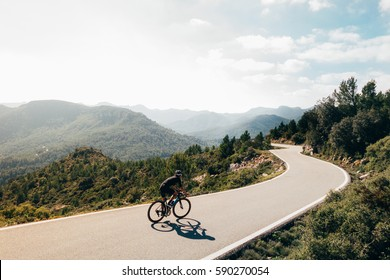 A cyclist on a mountain road