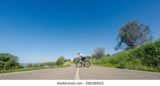Cyclist on road bike in the middle of the road