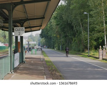 Cyclist on the so-called Nordbahntrasse a popular bike path, which was a former railway line in Wuppertal North Rhine Westphalia Germany along a station platform in September 2017