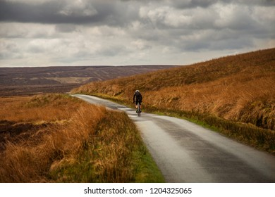 cyclist on wales country road