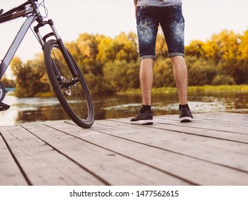 Cyclist on a wooden bridge and the last days of the outgoing summer