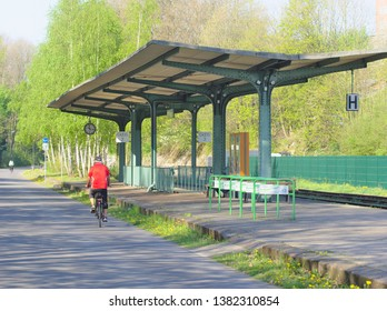 A cyclist passed the fomer railway station Loh on the Nordbahntrasse/ Wuppertal/ Germany in April 2019