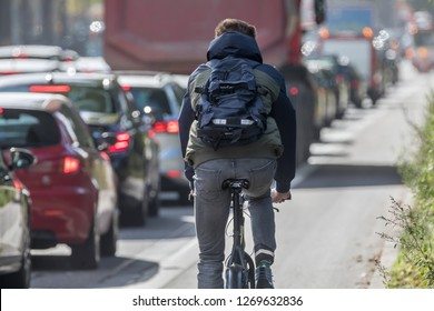 cyclist passing traffic jam