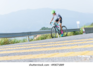 Cyclist pedaling on a racing bike outdoors