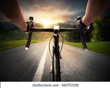 Cyclist pedaling on a street in daylight