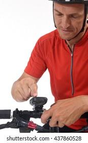 Cyclist programming the GPS