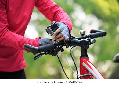 cyclist put the action camera on mountain bike