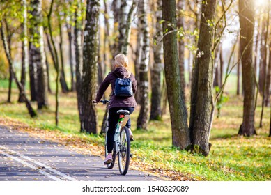 Cyclist ride on the bike path in the city Park