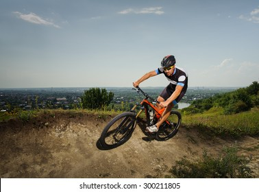 Cyclist rides downhill in the mountains