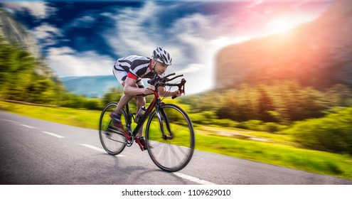Cyclist rides on bicycle, speed effect, side view