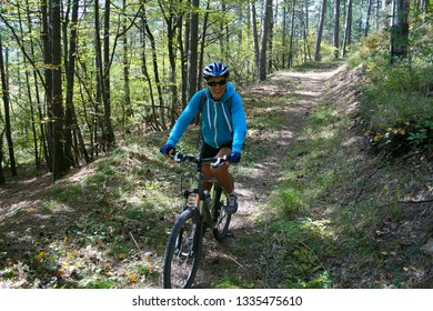 Cyclist rides on a forest trail, Crimea, Russia.