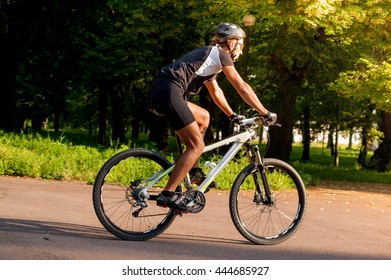 Cyclist rides through the park on a bicycle