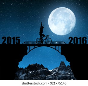 """Cyclist riding across the bridge in night. Forward to the New Year 2016. """"Elements of this image furnished by NASA""""."""