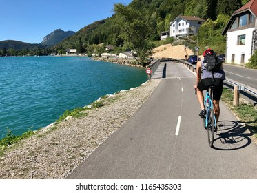 Cyclist riding around Lake Annecy, France